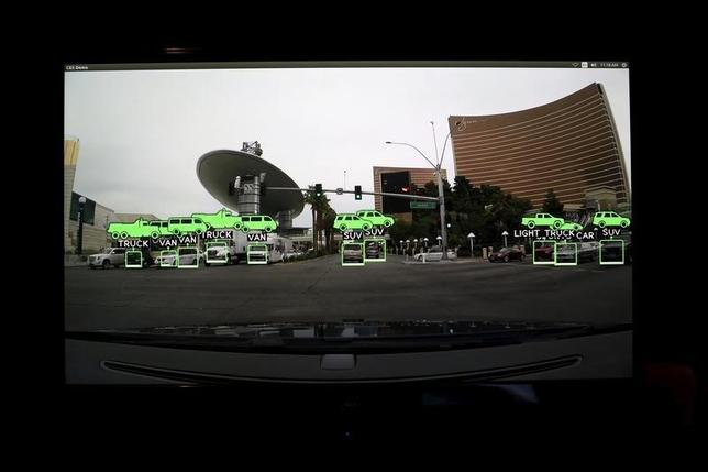 A video screen depicting the view of a self driving vehicle is shown on  a graphic display at Nvidia in Santa Clara, California in this February 11, 2015 file photo.  REUTERS/Robert Galbraith