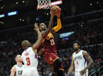 March 13, 2016; Los Angeles, CA, USA; Cleveland Cavaliers forward LeBron James (23) moves to the basket as he is fouled by Los Angeles Clippers guard Chris Paul (3) during the first half at Staples Center. Mandatory Credit: Gary A. Vasquez-USA TODAY Sports