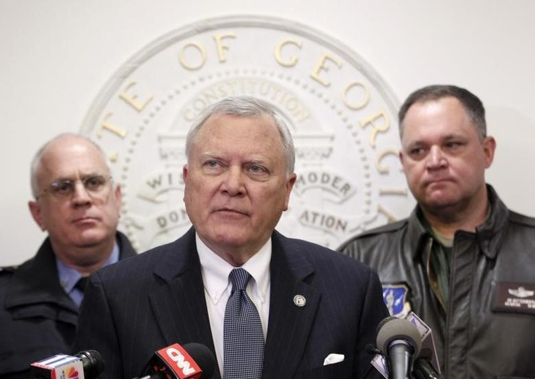Georgia Governor Nathan Deal (C), speaks to the media as Public Safety Director Mark McDonough (L), and Georgia National Guard Director General Jim Butterworth listen at the State Capitol in Atlanta, Georgia, January 30, 2014.  REUTERS/Tami Chappell