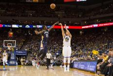Mar 14, 2016; Oakland, CA, USA; Golden State Warriors guard Stephen Curry (30) shoots the ball over New Orleans Pelicans guard Jrue Holiday (11) in the second half at Oracle Arena. The Warriors won 125-107. Mandatory Credit: Neville E. Guard-USA TODAY Sports