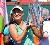 Mar 20, 2016; Indian Wells, CA, USA; Victoria Azarenka (BLR) holds the championship trophy after defeating Serena Williams (not pictured) in the women's final in the BNP Paribas Open at the Indian Wells Tennis Garden. Azarenka won 6-4, 6-4. Mandatory Credit: Jayne Kamin-Oncea-USA TODAY Sports