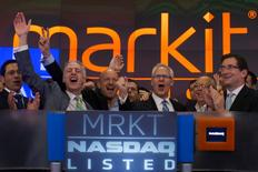 Markit Chief Executive Lance Uggla (3rd L) celebrates during the company's market debut at the Nasdaq stock market in New York June 19, 2014.  REUTERS/Adrees Latif