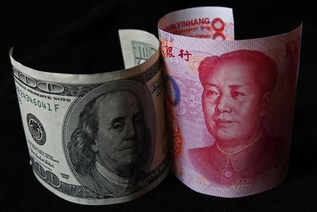 3月22日、中国の朱光耀財政次官は、為替相場の調整に関して米中間に密約はないと述べた。北京でのフォーラムで発言した。写真は北京で2010年11月撮影(2016年 ロイター/Petar Kujundzic)