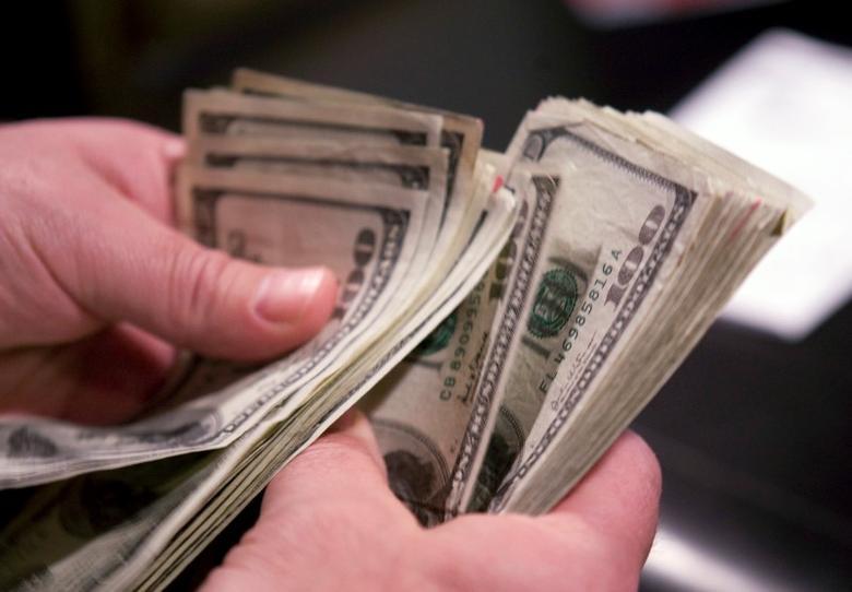 A man counts out cash in Las Vegas, Nevada January 27, 2011. REUTERS/Las Vegas Sun/Steve Marcus