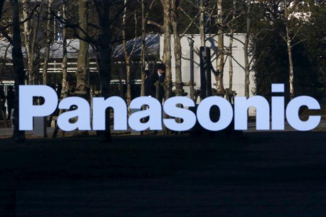 A pedestrian is reflected in a sign at Panasonic Center in Tokyo, Japan, February 3, 2016.REUTERS/Yuya Shino