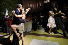 U.S. President Barack Obama and his wife Michelle dance tango during a state dinner hosted by Argentina's President Mauricio Macri at the Centro Cultural Kirchner as part of President Obama's two-day visit to Argentina, in Buenos Aires March 23, 2016.  REUTERS/Carlos Barria