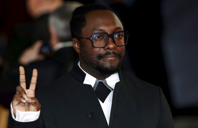 Singer songwriter Will.i.Am poses for photographers on the red carpet at the world premiere of the new James Bond 007 film ''Spectre'' at the Royal Albert Hall in London, Britain, October 26, 2015. REUTERS/Luke MacGregor