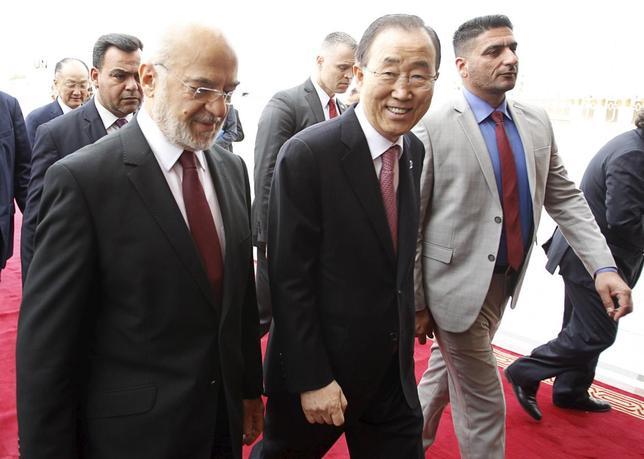 United Nations (U.N.) Secretary-General Ban Ki-moon (C) walks with Iraqi Foreign Minister Ibrahim al-Jaafari after arriving at Baghdad International Airport, Iraq March 26, 2016. REUTERS/Khalid al Mousily