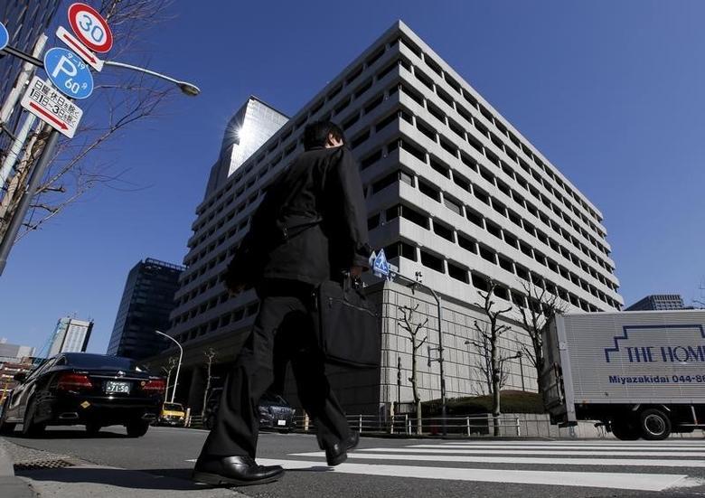 A man walks past the Bank of Japan (BOJ) building in Tokyo, Japan, March 15, 2016.     REUTERS/Toru Hanai