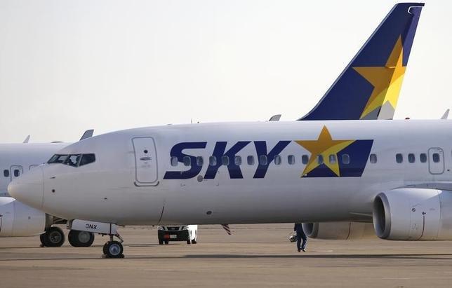 3月28日、国内航空3位のスカイマークは、すべての再生債権の弁済が完了する見通しとなり、同日付で東京地裁から民事再生手続きの終結決定を受けたと発表した。写真は都内で2014年11月撮影(2016年 ロイター/Toru Hanai)