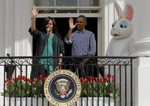 Obama e a primeira-dama dos EUA Michelle Obama durante evento na Casa Branca. 28/3/2016. REUTERS/Jonathan Ernst