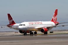 File photo of Virgin America flights landing in San Francisco, California, August 8, 2007. REUTERS/John Decker Virgin America/Pool