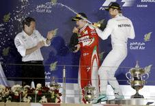 Formula One - Bahrain F1 Grand Prix - Sakhir, Bahrain - 03/04/16 - Mercedes F1 driver Nico Rosberg of Germany (R) Ferrari F1 driver Kimi Raikkonen of Finland (C) and Mercedes Team Engineer Director Aldo Costa (R) celebrate after winning the Bahrain GP. REUTERS/Hamad I Mohammed