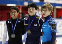 Gold medallist Noh Jin-Kyu (C) of South Korea, silver medallist  J.R. Celski (L) of the U.S. and bronze medallist Semen Elistratov of Russia pose following the men's 1500 meter final during the ISU Short Track World Cup competition in Montreal, Quebec  October 27, 2012. REUTERS/Christinne Muschi