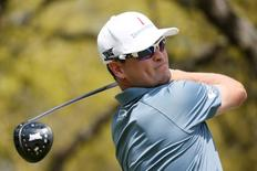 Zach Johnson watches his shot from the first hole during the first round of the Dell Match Play Championship golf tournament at Austin Country Club. Mandatory Credit: Soobum Im-USA TODAY Sports