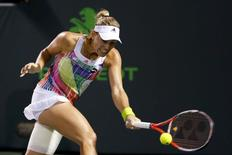 Angelique Kerber hits a forehand against Victoria Azarenka (not pictured) in a women's singles semifinal during day eleven of the Miami Open at Crandon Park Tennis Center. Azarenka won 6-2, 7-5.  Geoff Burke-USA TODAY Sports