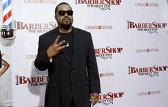 """Cast member Ice Cube poses at the premiere of """"Barbershop: The Next Cut"""" at TCL Chinese theatre in Hollywood, California April 6, 2016. REUTERS/Mario Anzuoni"""
