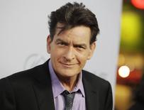 """Cast member Charlie Sheen poses at the premiere of his new film """"Scary Movie 5"""" in Hollywood, in this file photo taken April 11, 2013.  REUTERS/Fred Prouser/Files"""
