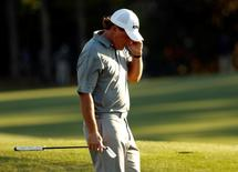 Apr 8, 2016; Augusta, GA, USA; Phil Mickelson reacts on the 18th green during the second round of the 2016 The Masters golf tournament at Augusta National Golf Club. Mandatory Credit: Rob Schumacher-USA TODAY Sports