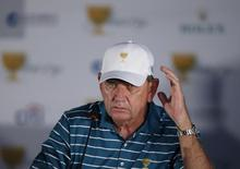 International team captain, Nick Price listens to a reporter's question at a news conference during the 2015 Presidents Cup golf tournament at the Jack Nicklaus Golf Club in Incheon, South Korea, October 6, 2015. REUTERS/Kim Hong-Ji
