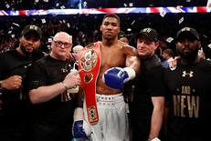 Anthony Joshua celebrates his win with his team Action Images via Reuters / Andrew Couldridge Livepic EDITORIAL USE ONLY.