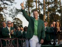 Danny Willett celebrates in the green jacket after winning the 2016 The Masters golf tournament at Augusta National Golf Club. Mandatory Credit: Rob Schumacher-USA TODAY Sports