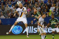 Apr 10, 2016; Carson, CA, USA; Los Angeles Galaxy defender Jelle Van Damme (37) heads the ball in front of Portland Timbers defender Nat Borchers (7) in the second half of the game at StubHub Center.  Jayne Kamin-Oncea-USA TODAY Sports