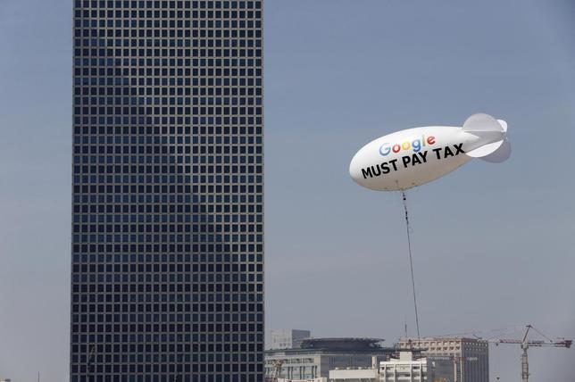 A blimp reading ''Google must pay tax'' is seen floating over the Tel Aviv skyline April 3, 2016.   REUTERS/Baz Ratner