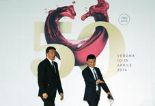 Founder and Executive Chairman of Alibaba Group Jack Ma (R) and Italy's Prime Minister Matteo Renzi (L) arrive at the Vinitaly wine exhibition in Verona, Italy, April 11 2016. REUTERS/Stefano Rellandini