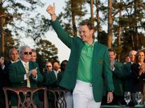 Apr 10, 2016; Augusta, GA, USA; Danny Willett celebrates in the green jacket after winning the 2016 The Masters golf tournament at Augusta National Golf Club. Mandatory Credit: Rob Schumacher-USA TODAY Sports