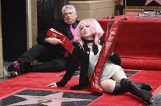 """Cyndi Lauper and Harvey Fierstein (L) pose for photographers after they receive stars on the """"Hollywood Walk of Fame"""" in Los Angeles April 11, 2016. REUTERS/Phil McCarten"""