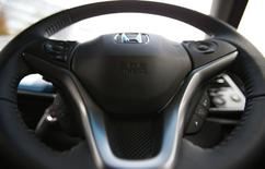 """An airbag logo is seen on a steering wheel of Honda Motor Co's all-new hybrid sedan """"Grace"""", which installed the airbag made by Takata Corp, during its unveiling event in Tokyo December 1, 2014. REUTERS/Toru Hanai"""
