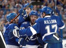 Apr 13, 2016; Tampa, FL, USA; Tampa Bay Lightning right wing Nikita Kucherov (86) is congratulated by center Alex Killorn (17) defenseman Nikita Nesterov (89), center Tyler Johnson (9) and defenseman Braydon Coburn (55) after he scored the against he Detroit Red Wings during the first period in game one of the first round of the 2016 Stanley Cup Playoffs at Amalie Arena.  Kim Klement-USA TODAY Sports