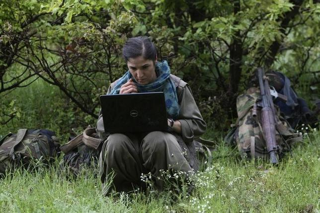 File photo of a member of Kurdistan Workers Party (PKK) works on her laptop in northern Iraq May 14, 2013. REUTERS/Azad Lashkari