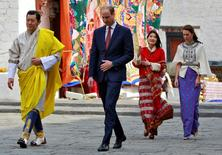 Britain's Prince William, Duke of Cambridge and his wife Catherine, Duchess of Cambridge are shown around the Tashichho Dzong temple by King Jigme Khesar Namgyel Wangchuck and his wife Jetsun Pema in Thimphu, Bhutan, April 14, 2016. REUTERS/Cathal McNaughton