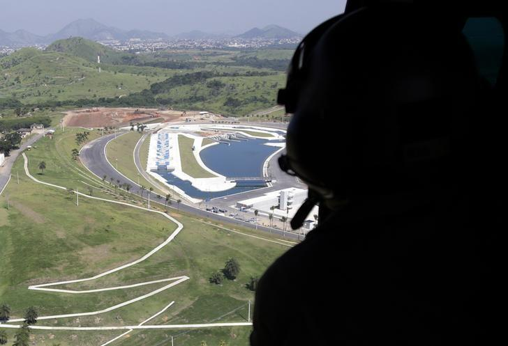 e09cc9c7d03 A Brazilian Army soldier observes the X-Park at Deodoro Sports Complex  during a flight as he takes part in an exercise ahead the 2016 Rio Olympics  in Rio de ...