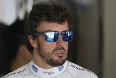 Formula One - Chinese Grand Prix - Shanghai, China - 4/15/16 - McLaren Formula One driver Fernando Alonso of Spain arrives at his garage during the first practice session.  REUTERS/Aly Song