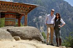 Britain's Prince William, Duke of Cambridge poses with his wife Catherine, Duchess of Cambridge in front of the Paro Taktsang Monastery, Bhutan, April 15, 2016.  REUTERS/Cathal McNaughton