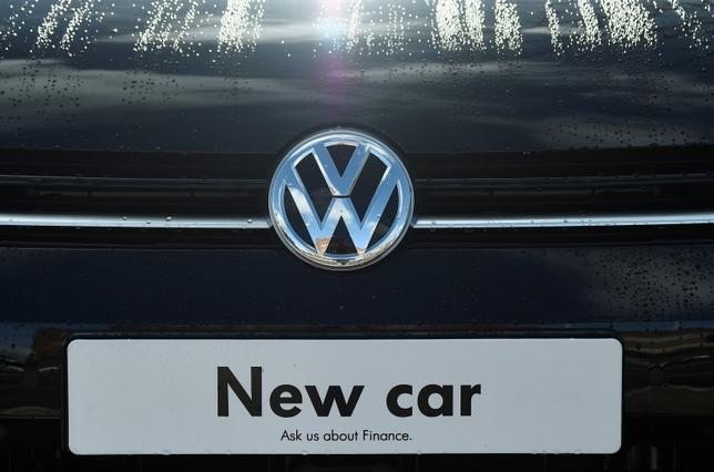 Signage for a new Volkswagen car is seen at a dealership in London, Britain, March 30, 2016. REUTERS/Toby Melville