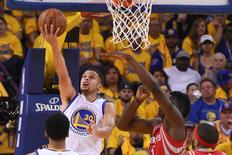 Golden State Warriors guard Stephen Curry (30) shoots the basketball against Houston Rockets forward Clint Capela (15) during the first quarter in game one of the first round of the NBA Playoffs at Oracle Arena. Mandatory Credit: Kyle Terada-USA TODAY Sports