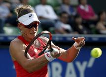 Samantha Stosur of Australia returns a shot to Belinda Bencic of Switzerland during their Pan Pacific Open women's singles tennis match in Tokyo, Japan, September 23, 2015. REUTERS/Yuya Shino