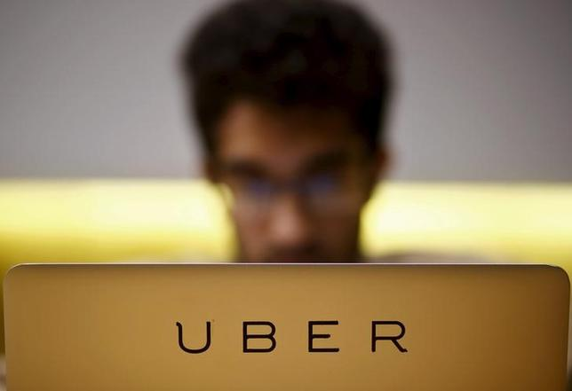An employee works inside the office of U.S. online cab-hailing company Uber, on the outskirts of New Delhi, India, April 24, 2015. REUTERS/Anindito Mukherjee