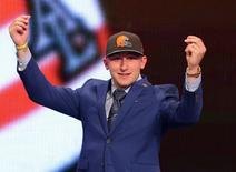 Johnny Manziel gestures after being selected by the Cleveland Browns in the first round of the 2014 NFL draft in New York, May 8, 2014. REUTERS/Brad Penner-USA TODAY Sports/Files