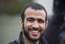 Omar Khadr smiles as he answers questions during a news conference after being released on bail in Edmonton, Alberta, Canada, May 7, 2015. REUTERS/Dan Riedlhuber/File photo