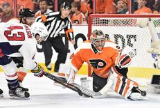 Philadelphia Flyers goalie Michal Neuvirth (30) makes the save against Washington Capitals right wing Tom Wilson (43) during the third period in game four of the first round of the 2016 Stanley Cup Playoffs at Wells Fargo Center. The Flyers won 2-1. Mandatory Credit: Eric Hartline-USA TODAY Sports