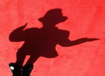"A shadow of a dancer impersonating Michael Jackson is cast on the red carpet during the Taiwan premiere of ""This Is It"" in Taipei October 28, 2009.  REUTERS/Nicky Loh"
