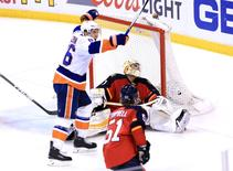 Apr 22, 2016; Sunrise, FL, USA; Florida Panthers goalie Roberto Luongo (1) gives up the game winning goal to New York Islanders center Alan Quine (not pictured) as left wing Nikolay Kulemin (86) celebrates in the second overtime of game five of the first round of the 2016 Stanley Cup Playoffs at BB&T Center.  Mandatory Credit: Robert Mayer-USA TODAY Sports