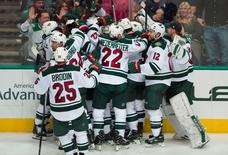 Apr 22, 2016; Dallas, TX, USA; The Minnesota Wild celebrate center Mikko Koivu (9) game winning goal against the Dallas Stars during the overtime period in game five of the first round of the 2016 Stanley Cup Playoffs at the American Airlines Center.  Mandatory Credit: Jerome Miron-USA TODAY Sports