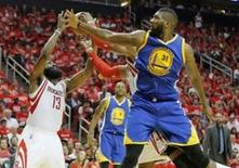 Apr 24, 2016; Houston, TX, USA; Houston Rockets guard James Harden (13) and Golden State Warriors center Festus Ezeli (31) reach for a loose ball in the second half in game four of the first round of the NBA Playoffs at Toyota Center. Thomas B. Shea-USA TODAY Sports