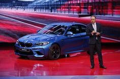 Ian Robertson, member of the Board of Management for BMW AG, introduces the 2016 BMW M2 Coupe at the North American International Auto Show in Detroit, January 11, 2016.   REUTERS/Mark Blinch
